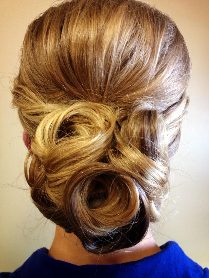 Get inspired by great ideas for styling your bridesmaids' hair, from braids, topknots, buns, and ponytails to half-up-half-down styles and straight and curly looks.
